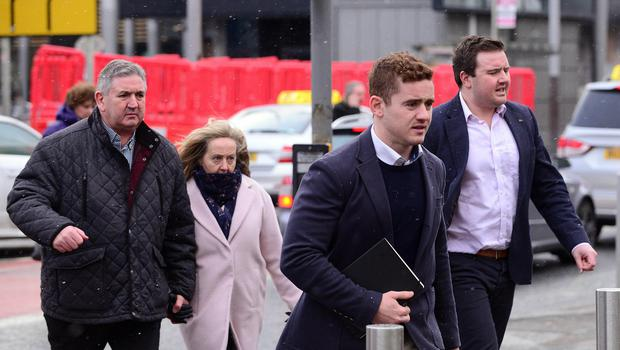 Ulster and Ireland rugby player Paddy Jackson arrives at Laganside Magistrates Court with members of his family