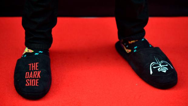 A fan wears Star Wars slippers as he arrives at the Australian premier of 'Star Wars: The Force Awakens' in Sydney on December 16, 2015. Star Wars: The Force Awakens opens to the general public on December 17, 2015. AFP PHOTO / Peter PARKSPETER PARKS/AFP/Getty Images