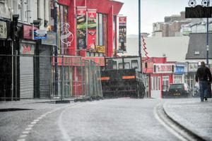 051213 PACEMAKER PRESS INTL. Main st. in Portrush is closed off after tiles and parts of the building came off as the North Coast was battered by Gale Force winds. Hail Storms and strong winds still continue throughout the day. PHOTO: Kirth Ferris / Pacemaker