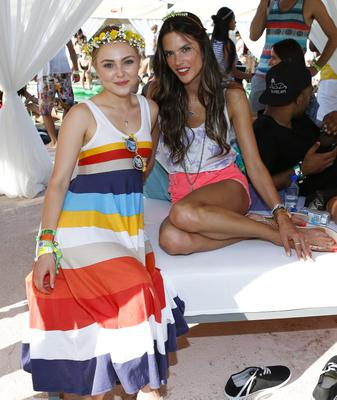 PALM SPRINGS, CA - APRIL 13:  Actress AnnaSophia Robb (L) and model Alessandra Ambrosio attend the FIJI Water At Lacoste L!VE Coachella Desert Pool Party on April 13, 2013 in Palm Springs, California.  (Photo by Imeh Akpanudosen/Getty Images for FIJI)