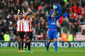 SUNDERLAND, ENGLAND - FEBRUARY 13: (L to R) Yann M'Vila, DeAndre Yedlin and Vito Mannone of Sunderland applaud supporters after their 2-1 win in the Barclays Premier League match between Sunderland and Manchester United at the Stadium of Light on February 13, 2016 in Sunderland, England.  (Photo by Clive Brunskill/Getty Images)