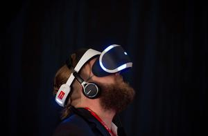 A visitor tries Sony's Project Morpheus virtual reality headset for PlayStation 4 at the booth of Japan's electronics giant Sony ahead of the opening of the 55th IFA (Internationale Funkausstellung), on September 2, 2015 in Berlin. IFA, one of the world's biggest consumer electronics shows, opens for the media before the public is invited from September 4 to 9.  AFP PHOTO / JOHN MACDOUGALLJOHN MACDOUGALL/AFP/Getty Images