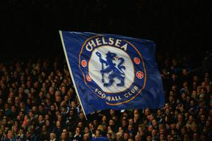 LONDON, ENGLAND - MARCH 18:  A Chelsea flag is waved prior to the UEFA Champions League Round of 16 second leg match between Chelsea and Galatasaray AS at Stamford Bridge on March 18, 2014 in London, England.  (Photo by Mike Hewitt/Getty Images)