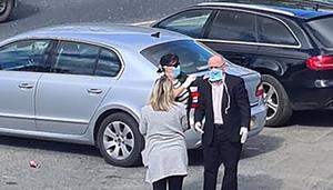 Close call: Barry McElduff gets help with his mask from colleague Anne Marie Fitzgerald