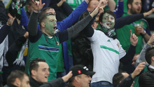 Proud: Northern Ireland supporters cheer on the team in Hannover