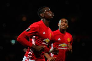 Paul Pogba of Manchester United celebrates after scoring the opening goal from the penalty spot during the UEFA Europa League Group A match between Manchester United FC and Fenerbahce SK at Old Trafford on October 20, 2016 in Manchester, England.  (Photo by Laurence Griffiths/Getty Images)