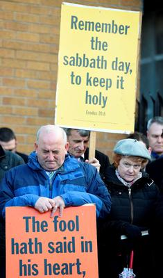 Members of the Tyndale Free Presbyterian Church hold an outdoor service near to Windsor Park  in protest against Northern Ireland's first match to be played on a Sunday, before the UEFA Euro 2016 Qualifier against Finland at Windsor Park, Belfast. Martin Rickett/PA Wire.