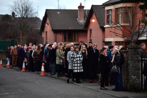 A long line of mourners queue to pay ther respects at the home of Martin McGuinness on March 22, 2017 in Londonderry, Northern Ireland. (Photo by Charles McQuillan/Getty Images)