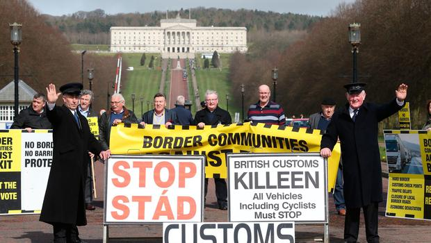 Anti-Brexit campaigners, some dressed as customs officers hold a protest outside Stormont in Belfast, as Prime Minister Theresa May triggers Article 50, starting the process that will see Britain leave the EU. Brian Lawless/PA Wire