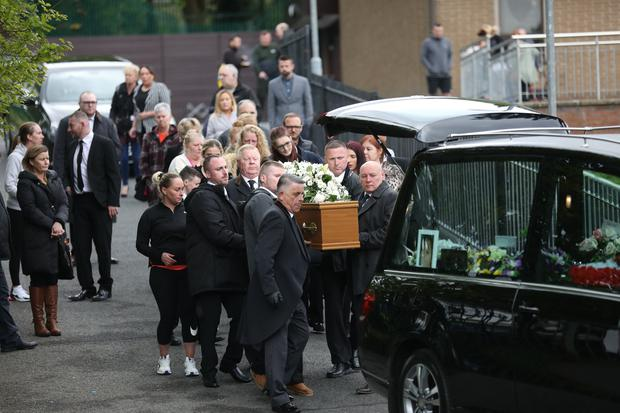 Family and Friends carry the coffin of Geraldine McKay following a funeral at St Michael The Archangel Church West Belfast. Pic by Peter Morrison