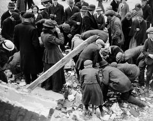 File photo dated 11/05/21916 of souvenir hunters of all ages scrabble amongst the rubble in the streets of Dublin in the aftermath of the 'Easter Rising'. PA