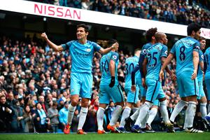 MANCHESTER, ENGLAND - DECEMBER 03:  Manchester City players celebrate their team's first goal during the Premier League match between Manchester City and Chelsea at Etihad Stadium on December 3, 2016 in Manchester, England.  (Photo by Clive Brunskill/Getty Images)