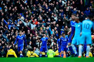 MANCHESTER, ENGLAND - DECEMBER 03: Diego Costa (C) of Chelsea celebrates scoring his team's first goal during the Premier League match between Manchester City and Chelsea at Etihad Stadium on December 3, 2016 in Manchester, England.  (Photo by Laurence Griffiths/Getty Images)