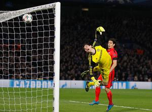 Chelsea's Belgian goalkeeper Thibaut Courtois (L) watches as the ball goes into his net off a header by Paris Saint-Germain's Brazilian defender Thiago Silva (not pictured) to give PSG their second goal. AFP/Getty Images
