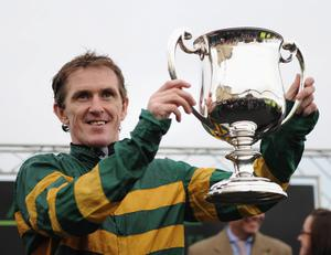 TOWCESTER, ENGLAND - NOVEMBER 07:  Tony McCoy riding Mountain Tunes celebrates after winning the Weatherbys Novices' Hurdle Race for his 4000th winner on November 7, 2013 in Towcester, England.  (Photo by Shaun Botterill/G2etty Images)