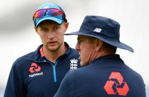 England's captain Joe Root (left) chats with coach Trevor Bayliss during the England cricket team's training session at The Oval yesterday. Photo: Getty Images