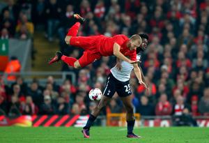"""Liverpool's Ragnar Klavan (left) and Tottenham Hotspur's Joshua Onomah (right) battle for the ball during the EFL Cup, round of 16 match at Anfield, Liverpool. PRESS ASSOCIATION Photo. Picture date: Tuesday October 25, 2016. See PA story SOCCER Liverpool. Photo credit should read: Nick Potts/PA Wire. RESTRICTIONS: EDITORIAL USE ONLY No use with unauthorised audio, video, data, fixture lists, club/league logos or """"live"""" services. Online in-match use limited to 75 images, no video emulation. No use in betting, games or single club/league/player publications."""