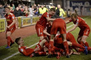 Cliftonville's Conor McMenamin celebrates after he rounds Coleraine's Chris Johns and slots home their fifth goal (Inpho/Stephen Hamilton)