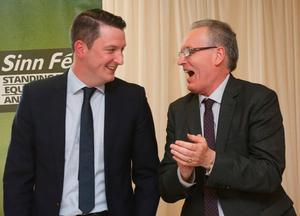 Sinn Fein MLA Gerry Kelly (right) congratulates John Finucane, son of murdered solicitor Pat Finucane, after he was announced as the party's candidate for North Belfast in the upcoming Westminster election, at an election convention in Belfast. PA