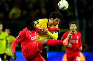 Liverpool's Belgian striker Divock Origi (L) and Dortmund's defender Mats Hummels vie for the ball during the UEFA Europe League quarter-final, first-leg football match Borussia Dortmund vs Liverpool FC in Dortmund, western Germany on April 7, 2016. / AFP PHOTO / John MACDOUGALLJOHN MACDOUGALL/AFP/Getty Images