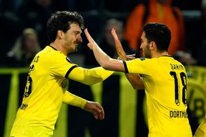 DORTMUND, GERMANY - APRIL 07:  Mats Hummels of Borussia Dortmund (L) celebrates with Nuri Sahin as he scores their first goal during the UEFA Europa League quarter final first leg match between Borussia Dortmund and Liverpool at Signal Iduna Park on April 7, 2016 in Dortmund, Germany.  (Photo by Stuart Franklin/Bongarts/Getty Images)