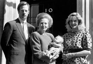 Library filer dated 3/5/1989 of Prime Minister Margaret Thatcher outside 10 Downing Street, in London, with her son Mark, daughter-in-law Diane, and two-month-old grandson Michael. PRESS ASSOCIATION Photo. Issue date: Monday April 8, 2013. Baroness Thatcher died this morning following a stroke, her spokesman Lord Bell said. See PA story DEATH Thatcher. Photo credit should read: PA/PA Wire