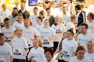 Press Eye - Belfast -  Northern Ireland - 24th June 2015 - Athletes take part in the warm up with Fitness Freddie at the first ever Grant Thornton Runway Run at Belfast City Airport this evening. Picture by Kelvin Boyes / Press Eye.