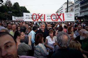 ATHENS, GREECE - JUNE 29: Demonstrators during a rally  in Athens, Greece, 29 June 2015. Greek voters will decide in a referendum next Sunday on whether their government should accept an economic reform package put forth by Greece's creditor. Greece has imposed capital controls with the banks being closed untill the referendum. (Photo by Milos Bicanski/Getty Images)