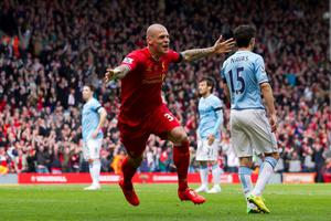 Liverpool's Martin Skrtel celebrates after scoring against Manchester City during their English Premier League soccer match at Anfield Stadium, Liverpool, England, Sunday April 13, 2014.