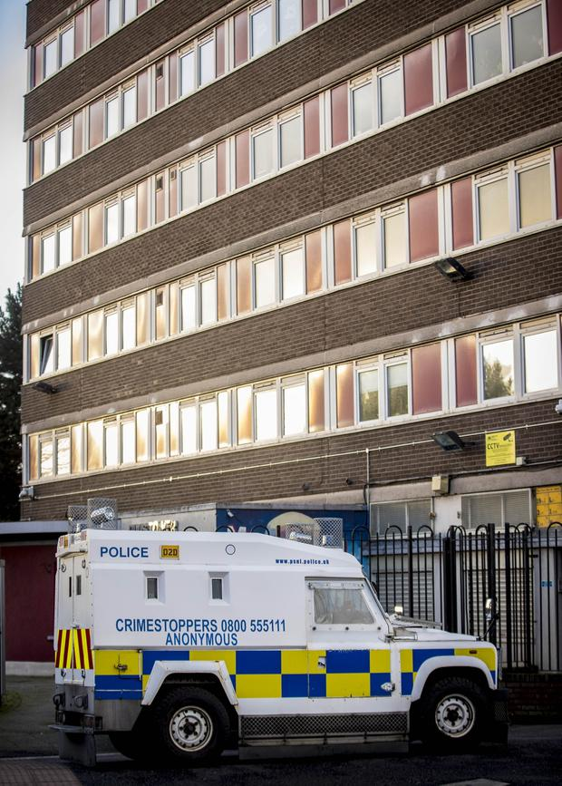 Police officers search a flat in the Divis Tower, west Belfast on December 9th 2019 (Photo by Kevin Scott for Belfast Telegraph)