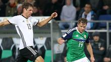 Tough test: Jamie Ward comes up against Thomas Muller in the World Cup qualifier in Germany