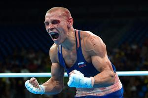 Blood covered Russia's Vladimir Nikitin reacts to winning against Ireland's Michael John Conlan during the Men's Bantam (56kg) Quarterfinal 1 match at the Rio 2016 Olympic Games at the Riocentro - Pavilion 6 in Rio de Janeiro on August 16, 2016. AFP/Getty Images
