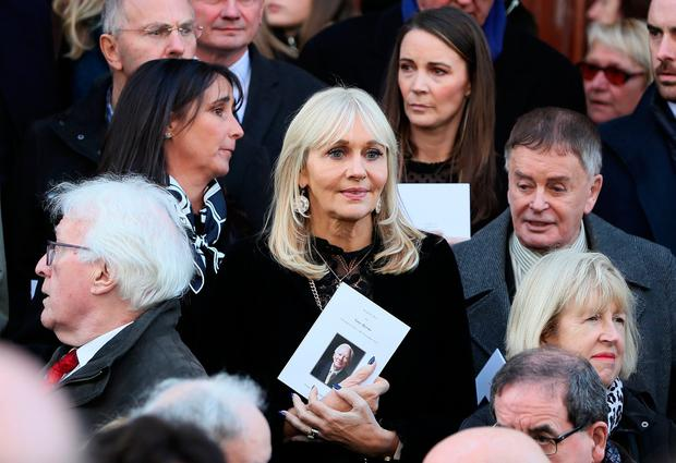 RTE broadcaster Miriam O'Callaghan (centre) among the mourners on the steps of St. Mary's Pro-Cathedral in Dublin following the funeral service of celebrated broadcaster Gay Byrne.