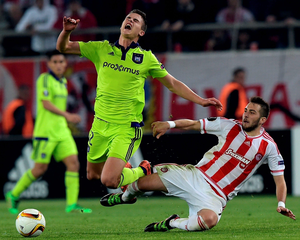 Olympiakos' Kostas Fortounis (right) is tackled by Anderlecht's Leander Dendoncker during the match