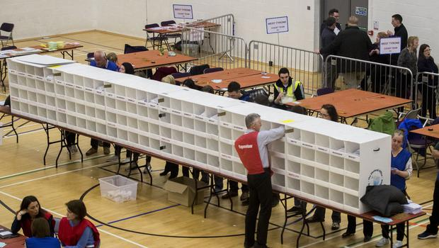 Election staff sort ballot papers at Omagh Leisure Complex (Liam McBurney/PA)