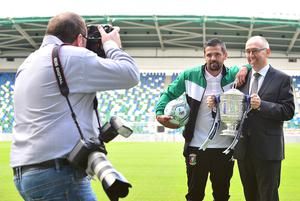 Pacemaker Press Belfast 03-08-2016:  launch event for the 2016/17 Danske Bank Football Premiership season.  Former Rangers striker Nacho Novo who signed with Glentoran FC pictured at the National Football Stadium at Windsor Park in Belfast with Danske Bank's chief executive, Kevin Kingston holding the Cup. Picture By: Arthur Allison.
