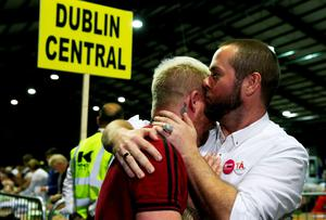 Jaime Nanci (left) and Michael Barron who were married in Cape Town five years ago at the RDS in Dublin,  re-act as early patterns suggest that the campaign to extend the right to marry to same-sex couples will succeed in the referendum on same-sex marriage.  PRESS ASSOCIATION Photo. Picture date: Saturday May 23, 2015. See PA story IRISH GayMarriage. Photo credit should read: Brian Lawless/PA Wire