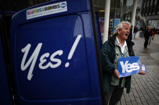 ABERDEEN, SCOTLAND - SEPTEMBER 15:  A yes campaigner stands by his branded van on September 15, 2014 in Aberdeen,Scotland. The latest polls in Scotland's independence referendum put the No campaign back in the lead, the first time they have gained ground on the Yes campaign since the start of August.  (Photo by Peter Macdiarmid/Getty Images)