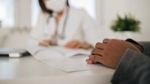 Close-up, doctor talking to her patient.