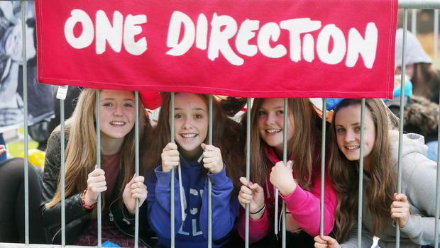 Press Eye - Belfast - Northern Ireland - 21st October 2015  One Direction fans queue up at the SSE Arena in Belfast ahead of tonight's concert.  The boy band, who are playing three nights in Belfast, cancelled last nights gig at the last minute.  The group made an announcement around lunch time to say they were going ahead with the rest of the shows and are rescheduling the canceled performance to Friday night.   Left to tight.  Rebecca Millar, Julia Leslie, Sasha Larkin and Katie McNeilly.  Picture by Jonathan Porter/PressEye