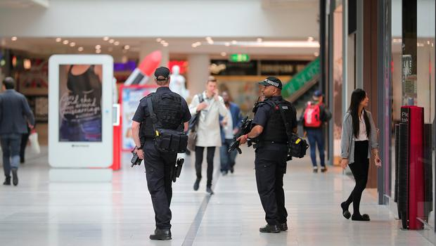 MANCHESTER, ENGLAND - MAY 23:  Armed police patrol the Arndale Shopping Centre after the terrorist attack,  May 23, 2017 in Manchester, England. An explosion occurred at Manchester Arena as concert goers were leaving the venue after Ariana Grande had performed. Greater Manchester Police are treating the explosion as a terrorist attack and have confirmed 22 fatalities and 59 injured.  (Photo by Christopher Furlong/Getty Images)