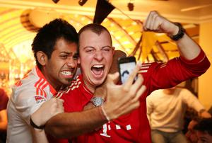LONDON, ENGLAND - MAY 25:  Bayern Munich fans in the Bavarian Beerhouse bar celebrates their team winning in their Champions League final against Borussia Dortmund on May 25, 2013 in London, England. Bayern Munich beat Borussia Dortmund 2-1 to win The Champions League final at Wembley Stadium.  (Photo by Peter Macdiarmid/Getty Images)
