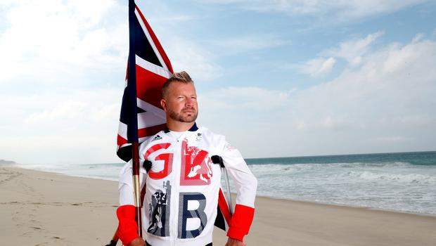 RIO DE JANEIRO, BRAZIL - SEPTEMBER 06:  Equestrian rider Lee Pearson of Great Britain poses for a photo call on the beach after being chosen as Great Britain's flagbearer for the Paralympic Games on September 6, 2016 in Rio de Janeiro, Brazil.  (Photo by Matthew Stockman/Getty Images)