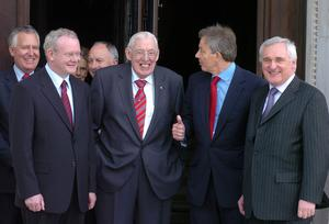 PACEMAKER BELFAST 8/5/2007. Well done Tony! Prime Minister Tony Blair leaves Stormont Parliment on the first day of the Northern Ireland Assembly with Bertie Ahern watched by First Minister and Deputy First Minister Ian Paisley and Martin McGuinness. Picture Charles McQuillan/Pacemaker