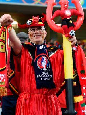 A Belgium supporter gestures before the Euro 2016 quarter-final football match between Wales and Belgium at the Pierre-Mauroy stadium in Villeneuve-d'Ascq near Lille, on July 1, 2016. / AFP PHOTO / MIGUEL MEDINAMIGUEL MEDINA/AFP/Getty Images