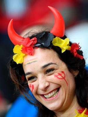 A Belgium supporter smiles before the Euro 2016 quarter-final football match between Wales and Belgium at the Pierre-Mauroy stadium in Villeneuve-d'Ascq near Lille, on July 1, 2016. / AFP PHOTO / MIGUEL MEDINAMIGUEL MEDINA/AFP/Getty Images