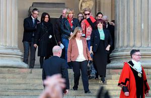 Margaret Aspinall (C), whose son James died in the 1989 Hillsborough disaster, leads other relatives of the victims on the steps of St George's Hall in Liverpool, north west England on April 27, 2016, during an event in remembrance of the 96 Liverpool fans who died in the 1989 Hillsborough football stadium disaster. Thousands of sympathisers paid an emotional tribute to the Hillsborough disaster victims today after a landmark inquest found that 96 Liverpool football fans were unlawfully killed. / AFP PHOTO / PAUL ELLISPAUL ELLIS/AFP/Getty Images