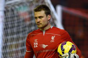 Liverpool's Belgian goalkeeper Simon Mignolet warms up ahead of the English Premier League football match between Liverpool and Tottenham Hotspur at the Anfield stadium in Liverpool, northwest England, on February 10, 2015.