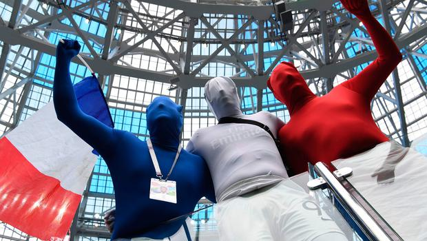 TOPSHOT - France's fans pose past a national flag before the Russia 2018 World Cup quarter-final football match between Uruguay and France at the Nizhny Novgorod Stadium in Nizhny Novgorod on July 6, 2018. / AFP PHOTO / Kirill KUDRYAVTSEVKIRILL KUDRYAVTSEV/AFP/Getty Images
