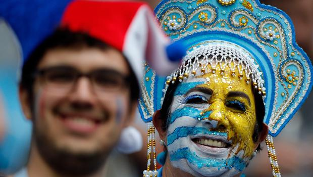 A Uruguay, right, and French fans wait for the start of the quarterfinal match between Uruguay and France at the 2018 soccer World Cup in the Nizhny Novgorod Stadium, in Nizhny Novgorod, Russia, Friday, July 6, 2018. (AP Photo/Ricardo Mazalan)